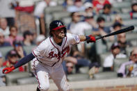 Atlanta Braves' Dansby Swanson (7) follows through on a single during the fifth inning of Game 3 of a baseball National League Division Series against the Milwaukee Brewers, Monday, Oct. 11, 2021, in Atlanta. (AP Photo/John Bazemore)