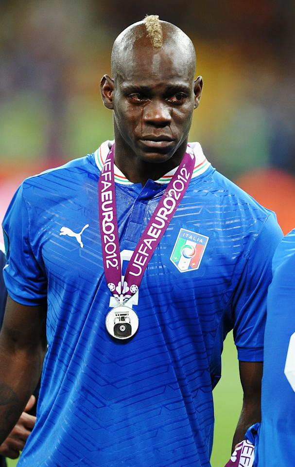 KIEV, UKRAINE - JULY 01:  Mario Balotelli of Italy cries as he shows his dejection following defeat in the UEFA EURO 2012 final match between Spain and Italy at the Olympic Stadium on July 1, 2012 in Kiev, Ukraine.  (Photo by Laurence Griffiths/Getty Images)