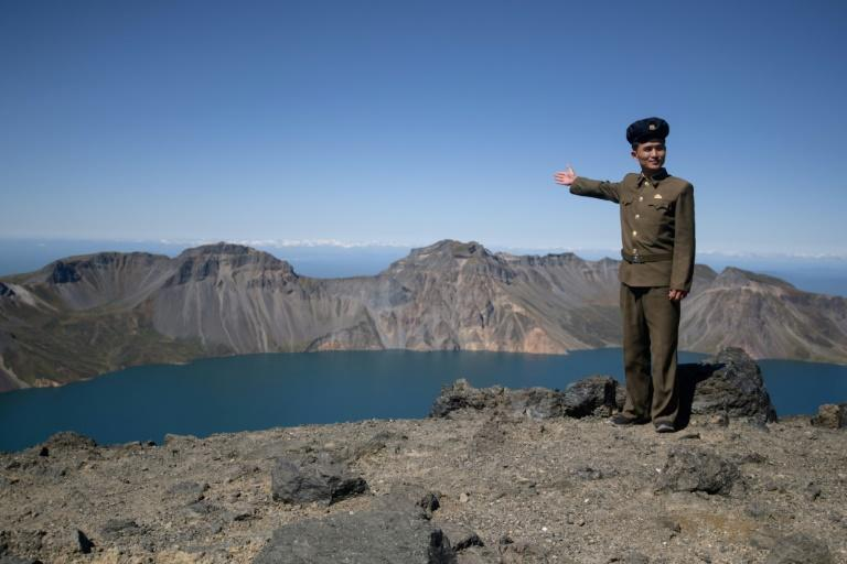 The eruption of Mount Paektu in 946 left behind a spectacular caldera, with steep walls plunging down to the shores of Chonji crater lake -- Heaven Lake in English (AFP Photo/Ed JONES)