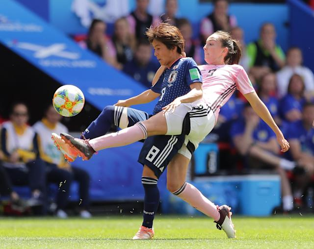 RENNES, FRANCE - JUNE 14: Caroline Weir of Scotland is challenged by Mana Iwabuchi of Japan during the 2019 FIFA Women's World Cup France group D match between Japan and Scotland at Roazhon Park on June 14, 2019 in Rennes, France. (Photo by Richard Heathcote/Getty Images)