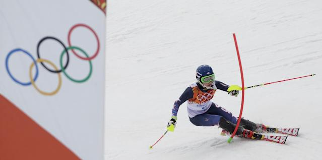 United States' Mikaela Shiffrin skis past a gate during the women's slalom at the Sochi 2014 Winter Olympics, Friday, Feb. 21, 2014, in Krasnaya Polyana, Russia. (AP Photo/Gero Breloer)