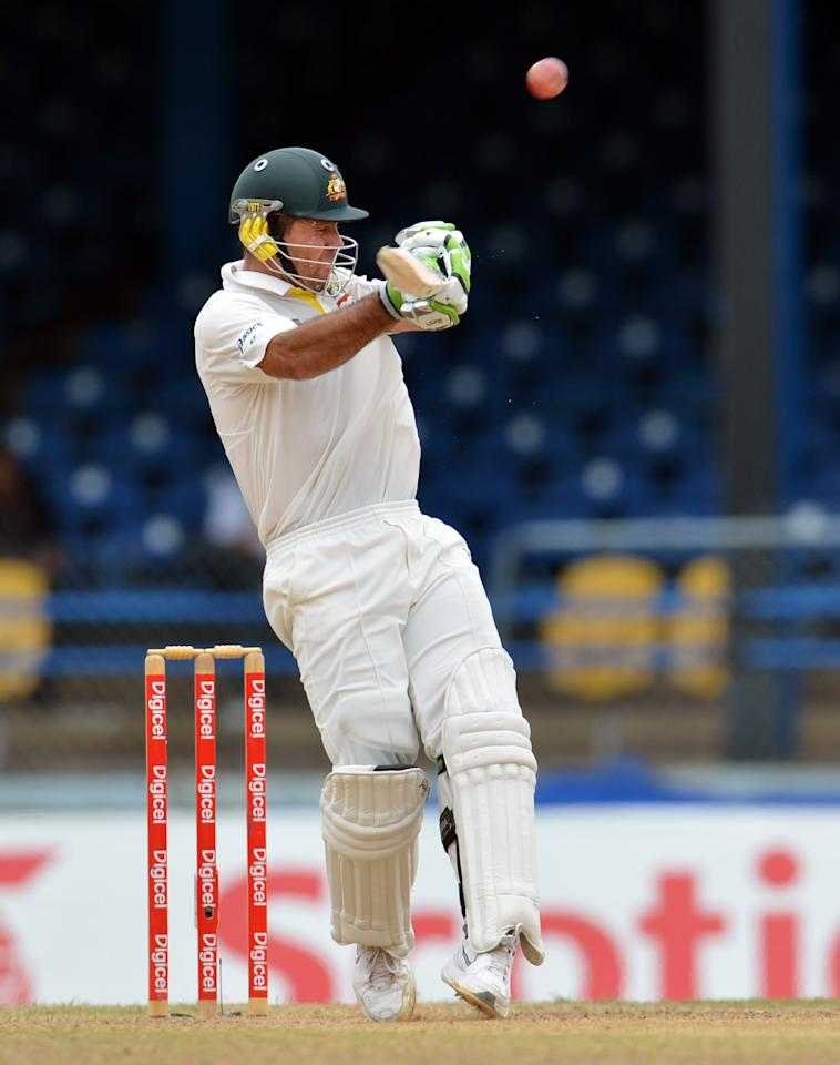 Australian batsman Ricky Ponting plays a shot that was caught out by West Indies cricketer Kieran Powell during the final day of the second-of-three Test matches between Australia and West Indies April19, 2012 at Queen's Park Oval in Port of Spain, Trinidad.