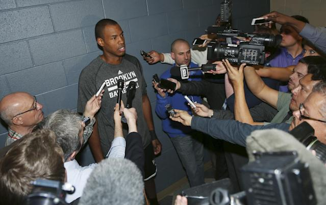 Brooklyn Nets center Jason Collins talks to reporters before the Nets faced the Denver Nuggets in an NBA basketball game in Denver on Thursday, Feb. 27, 2014. (AP Photo/David Zalubowski)