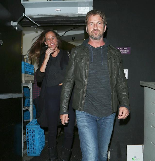 Morgan Brown and Gerard Butler leaving a West Hollywood club in July 2015. (Photo: Splash News)