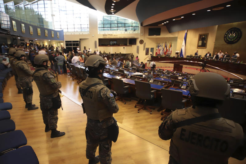 Armed Special Forces soldiers of the Salvadoran Army, following orders of President Nayib Bukele, enter congress upon the arrival of lawmakers, in San Salvador, El Salvador, Sunday, Feb. 9, 2020. Bukele has called on supporters to converge around the country's parliament after legislators refused to gather to vote on a $109 million loan to better equip the country's security forces. Top commanders of the country's police and military have expressed allegiance to the president during the standoff, while positioning security forces in and around the legislative building. (AP Photo/Salvador Melendez)