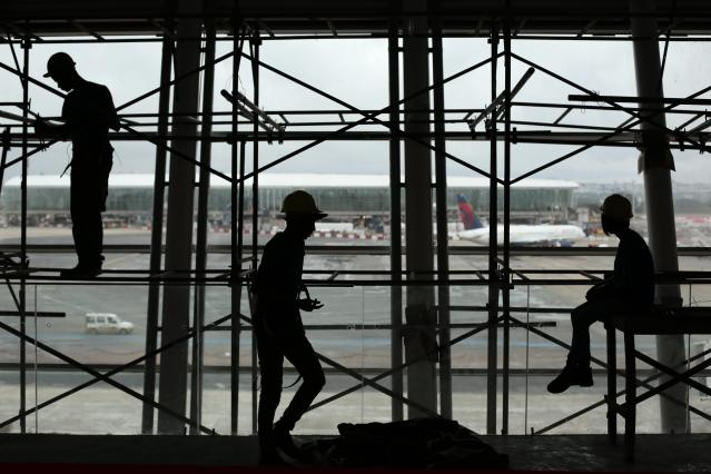 Workers are pictured during renovation and expansion works at Juscelino Kubitschek International Airport in Brasilia March 27, 2014. Brasilia is one of the host cities for the 2014 FIFA World Cup in Brazil. REUTERS/Ueslei Marcelino (BRAZIL - Tags: SPORT SOCCER TRANSPORT TPX IMAGES OF THE DAY)