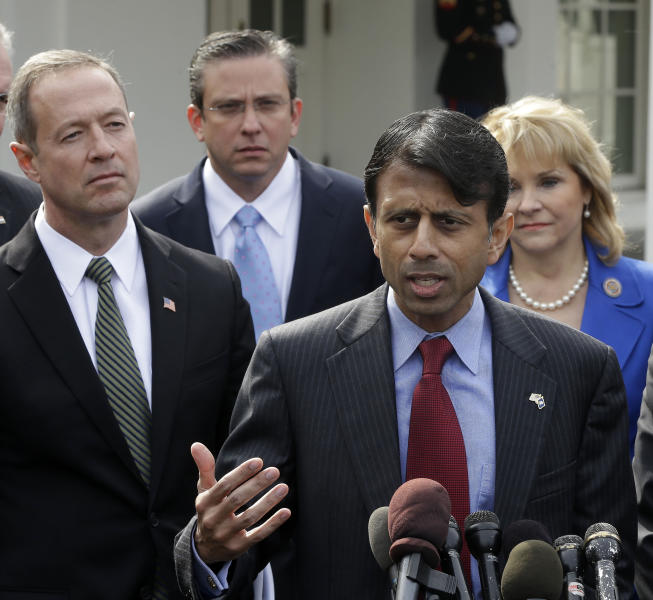 Louisiana Gov. Bobby Jindal answers questions during a news conference outside the White House in Washington, Monday, Feb. 25, 2013, following a meeting between National Governors Association (NGA) and President Barack Obama. From left are, Maryland Gov. Martin O'Malley, Puerto Rico Gov. Alejandro García Padilla, Jindal, and NGA Vice Chair, Oklahoma Gov. Mary Fallin. (AP Photo/Pablo Martinez Monsivais)