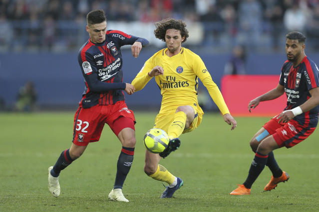 Adrien Rabiot of Paris Saint Germain challenges for the ball with Jessy Deminguet of Caen during their League One soccer match at the Michel d'Ornano stadium in Caen, western France, Saturday, May 19, 2018. (AP Photo/David Vincent)