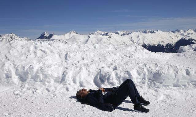 A man enjoys a sunny afternoon on top of the mountain of Rosa Khutor during the 2014 Sochi Winter Olympics,