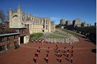 <p>The Foot Guards Band stand in formation outside St George's Chapel at Windsor Castle. </p>