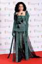 <p>Celeste goes all out in this puffy sleeve jade number, with floral finishes and a semi-sheer skirt.</p>