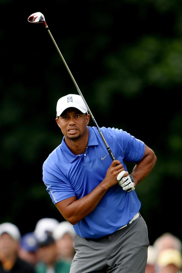 ARDMORE, PA - JUNE 13: Tiger Woods of the United States watches his tee shot on the third hole during Round One of the 113th U.S. Open at Merion Golf Club on June 13, 2013 in Ardmore, Pennsylvania. (Photo by Ross Kinnaird/Getty Images)