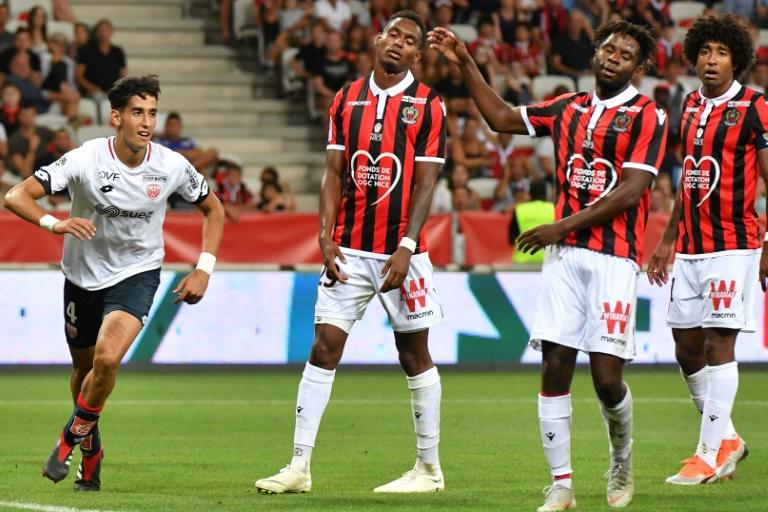 Nice players look on in disgust after Nayef Aguerd's opening goal for Dijon