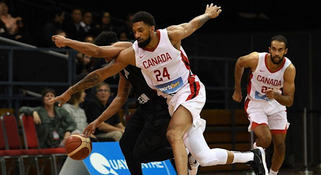 Canada's Khem Birch (front) challenges New Zealand's Corey Webster (L) during their friendly basketball match in Sydney on August 20, 2019. (SAEED KHAN/AFP/Getty Images)