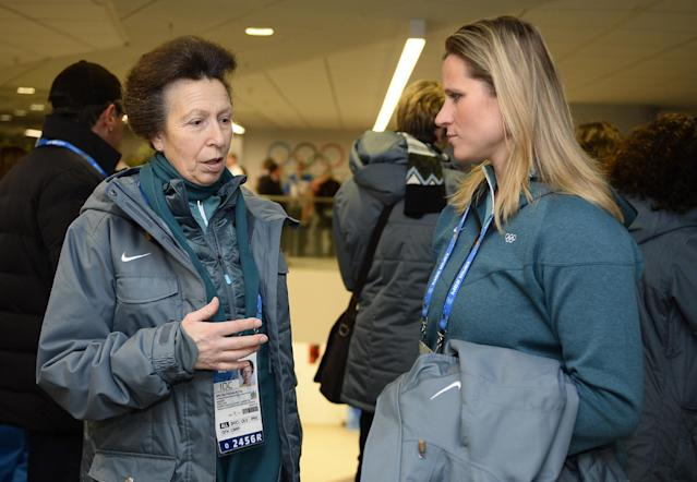 Britain's Princess Anne, left, speaks with an unidentified person upon her arrival for the opening ceremony of the 2014 Winter Olympics in Sochi, Russia, Friday, Feb. 7, 2014. (AP Photo/Lionel Bonaventure, Pool)
