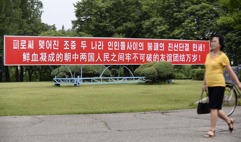 """The signboard, which reads """"Long Live with Unbreakable Friendship and Unity Formed by Blood"""" in Chinese and Korean language respectively, is displayed in Pyongyang, North Korea, Thursday, June 20, 2019.  The leaders of China and North Korea were talking in the North Korean capital Thursday, with stalled nuclear negotiations with Washington expected to be on the agenda.(Kyodo News via AP)"""