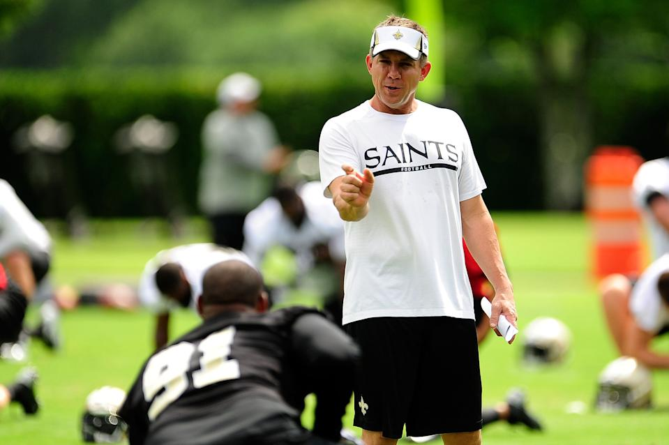 METAIRIE, LA - MAY 23:  Head coach Sean Payton of the New Orleans Saints speaks with Will Smith #91 during OTA's, organized team activities, at the Saints training facility on May 23, 2013 in Metairie, Louisiana.  (Photo by Stacy Revere/Getty Images)