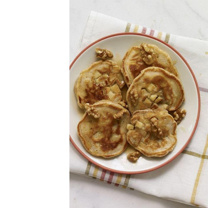 """<p>Diced apple pieces and toasted maple walnuts on top of perfectly fluffy pancakes makes for the perfect Father's Day morning.</p><p><a href=""""https://www.womansday.com/food-recipes/food-drinks/recipes/a12264/apple-pie-pancakes-maple-walnuts-recipe-wdy0113/"""" rel=""""nofollow noopener"""" target=""""_blank"""" data-ylk=""""slk:Get the Apple Pie Pancakes With Maple Walnuts recipe."""" class=""""link rapid-noclick-resp""""><em>Get the Apple Pie Pancakes With Maple Walnuts recipe.</em></a></p>"""