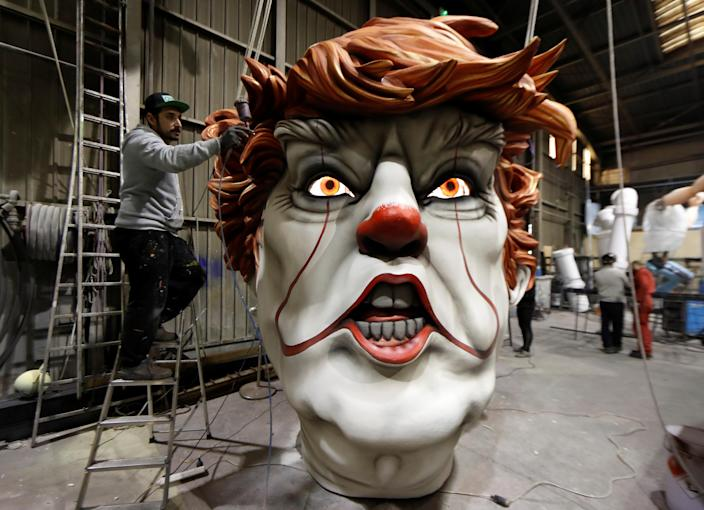 <p>A worker puts the final touches on a giant figure of U.S. President Donald Trump during preparations for the carnival parade in Nice, France, Feb. 4, 2019. (Photo: Eric Gaillard/Reuters) </p>
