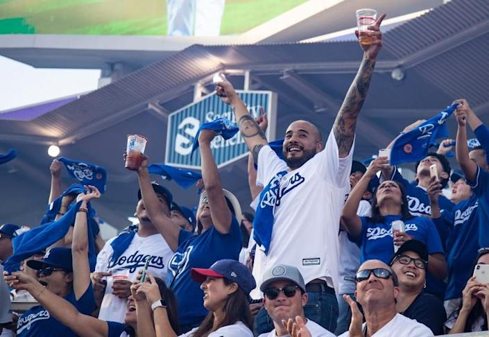 LOS ANGELES, CA - OCTOBER 3, 2019: Dodger fans cheer as the Dodgers starting line-up is announced before Game 1.