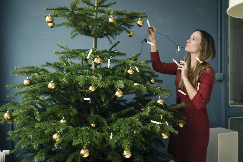 Brits say putting up their Christmas tree gets them in the festive spirit [Photo: Getty]