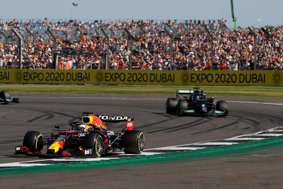 Max Verstappen leads Lewis Hamilton ahead of winning the Sprint race at Silverstone  (AFP via Getty Images)