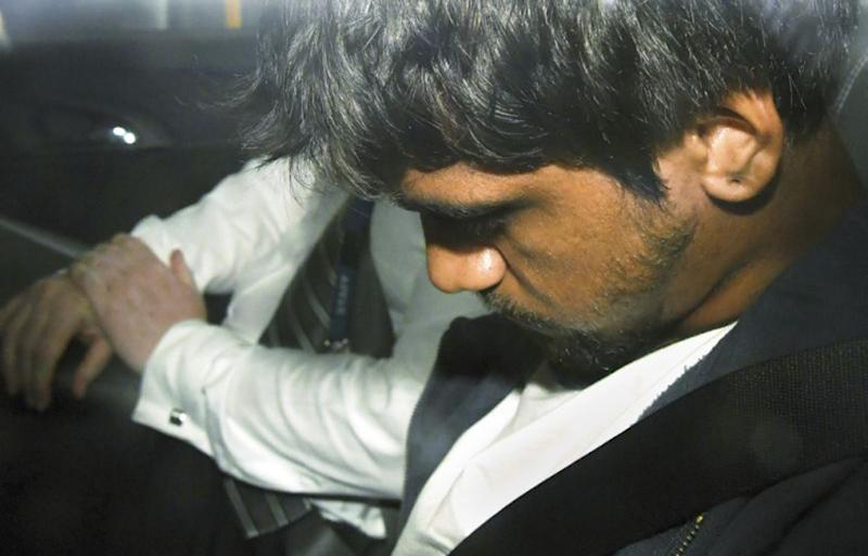 Codey Herrmann sits in a police car after he was arrested over the death of Israeli student Aiia Maasarwe in Melbourne.