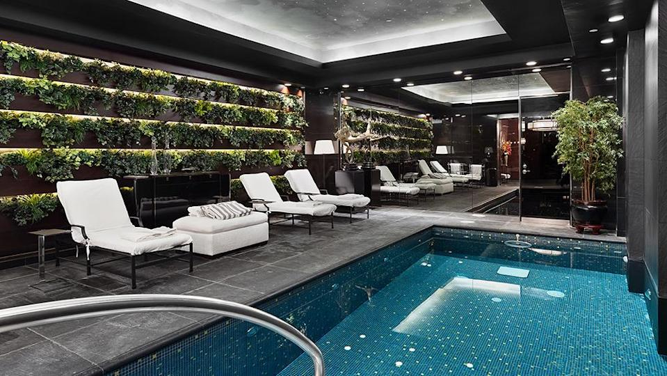 """The 20-foot indoor pool, which sits beneath a ceiling of LED """"stars."""" - Credit: Photo: Courtesy of The Corcoran Group"""