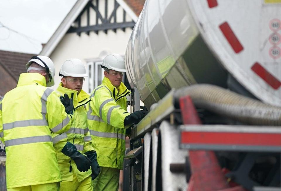 Members of the armed forces work on a fuel tanker at a garage in Waltham Abbey, Essex (PA) (PA Wire)