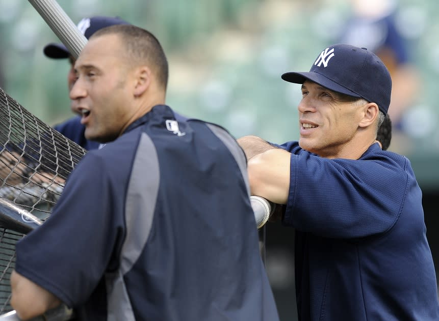 Derek Jeter (left) and Joe Girardi (pictured in 2011) were the two most notable absences from the Yankees 1998 reunion. (AP)