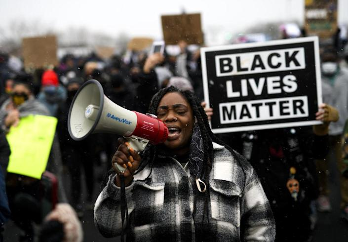 Protesters march outside the Brooklyn Center police headquarters on April 13, 2021 in Brooklyn Center, Minnesota