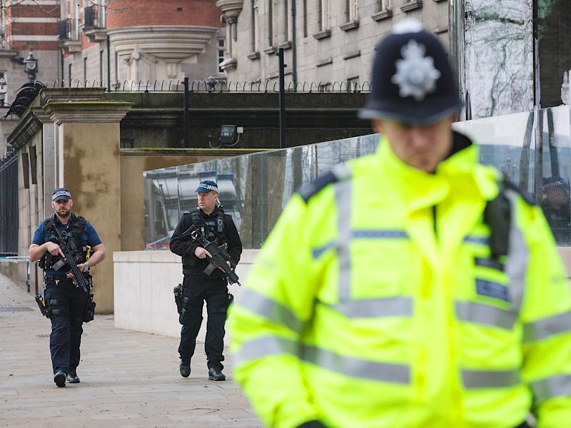 Armed police officers patrol outside New Scotland Yard following yesterday's attack in London: Getty Images