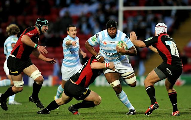 Racing's Lock Jone Qovu Nailiko (2nd R) attempts to break a tackle from Saracen's Hooker Schalk Brits (C) and Petrus Du Plessis (R) during the Heineken Cup rugby union match between Saracens and Racing Metro 92 at Vicarage Road in Watford on December 11, 2010. AFP PHOTO / Adrian Dennis (Photo credit should read ADRIAN DENNIS/AFP/Getty Images)