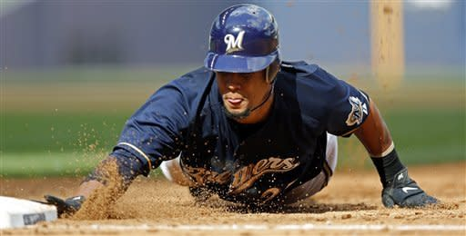 Milwaukee Brewers' Carlos Gomez slides back to first safely on a pick-off attempt by Miami Marlins' Anibal Sanchez during the fifth inning of a baseball game, Tuesday, July 3, 2012, in Milwaukee. (AP Photo/Tom Lynn)