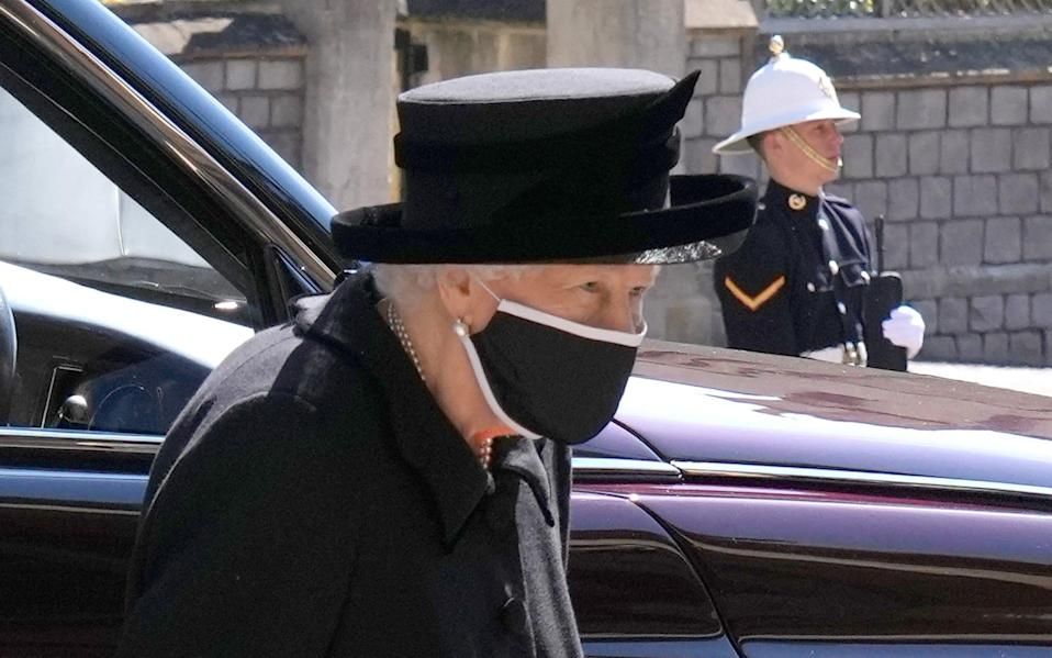 The Queen had to sit alone during the funeral due to social distancing regulations - Jonathan Brady/Pool via REUTERS