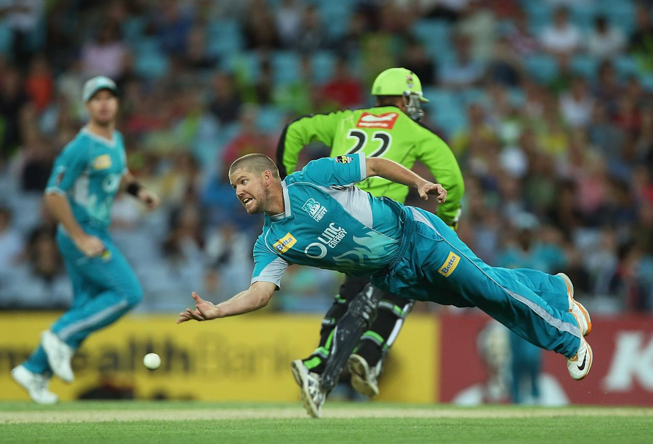 SYDNEY, AUSTRALIA - DECEMBER 28:  James Hopes of the Heat dives to run out   Usman Khawaja of the Thunder during the Big Bash League match between the Sydney Thunder and the Brisbane Heat at ANZ Stadium on December 28, 2012 in Sydney, Australia.  (Photo by Mark Metcalfe/Getty Images)