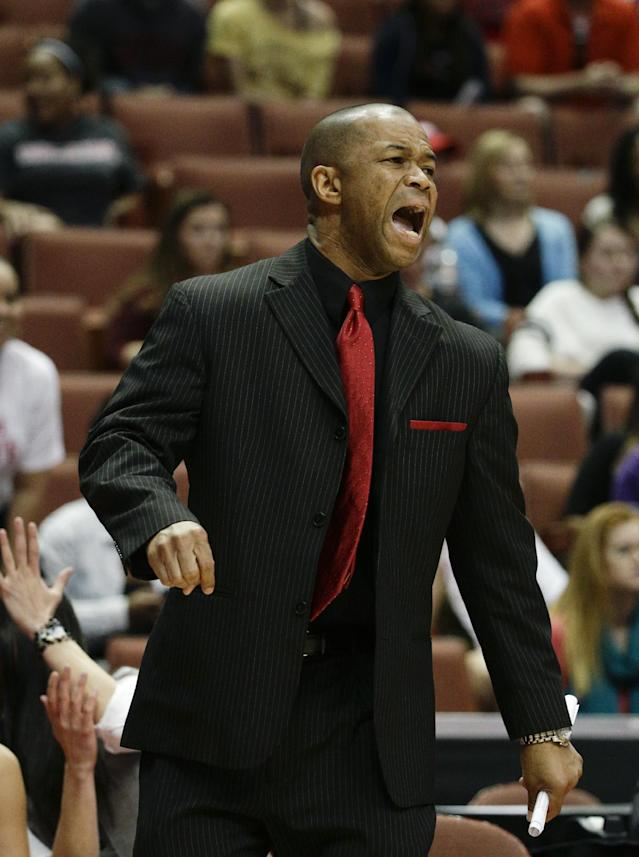 Cal State Northridge head coach Jason Flowers directs his team during the first half of an NCAA college basketball game against Cal Poly in the final of the Big West Conference tournament, on Saturday, March 15, 2014, in Anaheim, Calif. (AP Photo/Jae C. Hong)