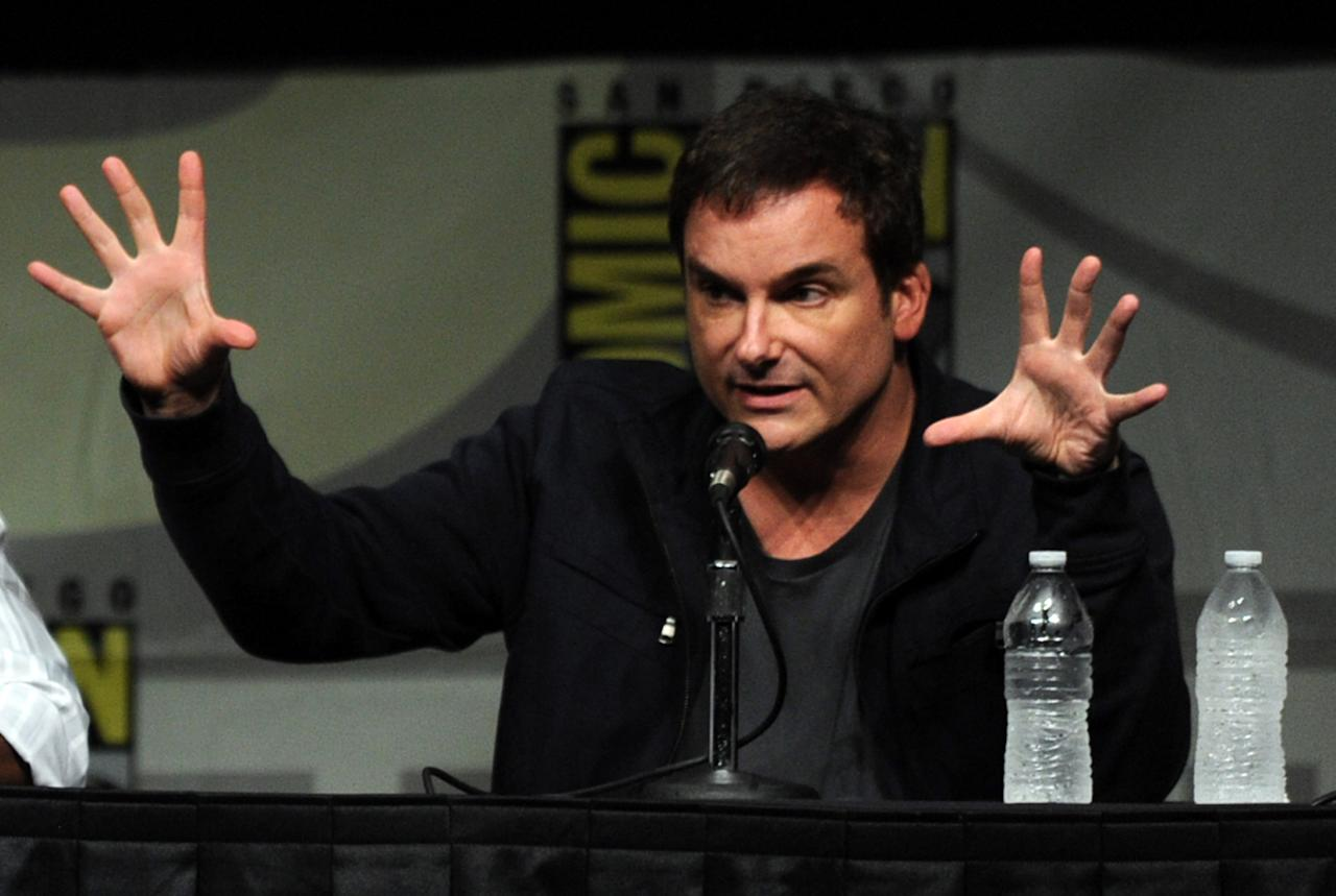 """SAN DIEGO, CA - JULY 14:  Director Shane Black speaks at Marvel Studios """"Iron Man 3"""" panel during Comic-Con International 2012 at San Diego Convention Center on July 14, 2012 in San Diego, California.  (Photo by Kevin Winter/Getty Images)"""