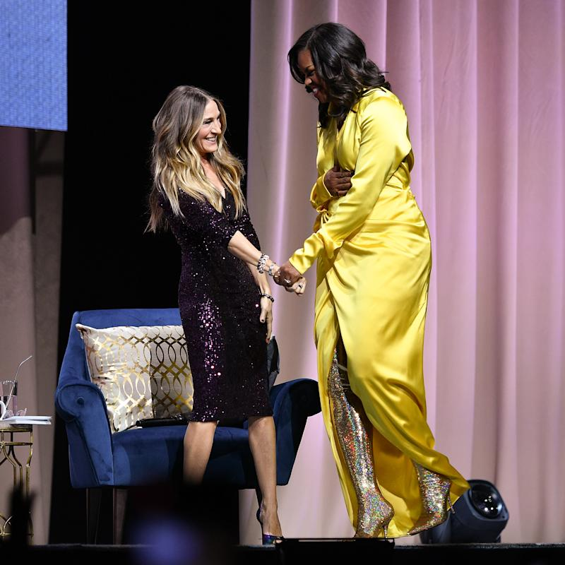 NEW YORK, NEW YORK - DECEMBER 19: Former first lady Michelle Obama (R) discusses her book 'Becoming' with Sarah Jessica Parker at Barclays Center on December 19, 2018 in New York City. (Photo by Dia Dipasupil/Getty Images)
