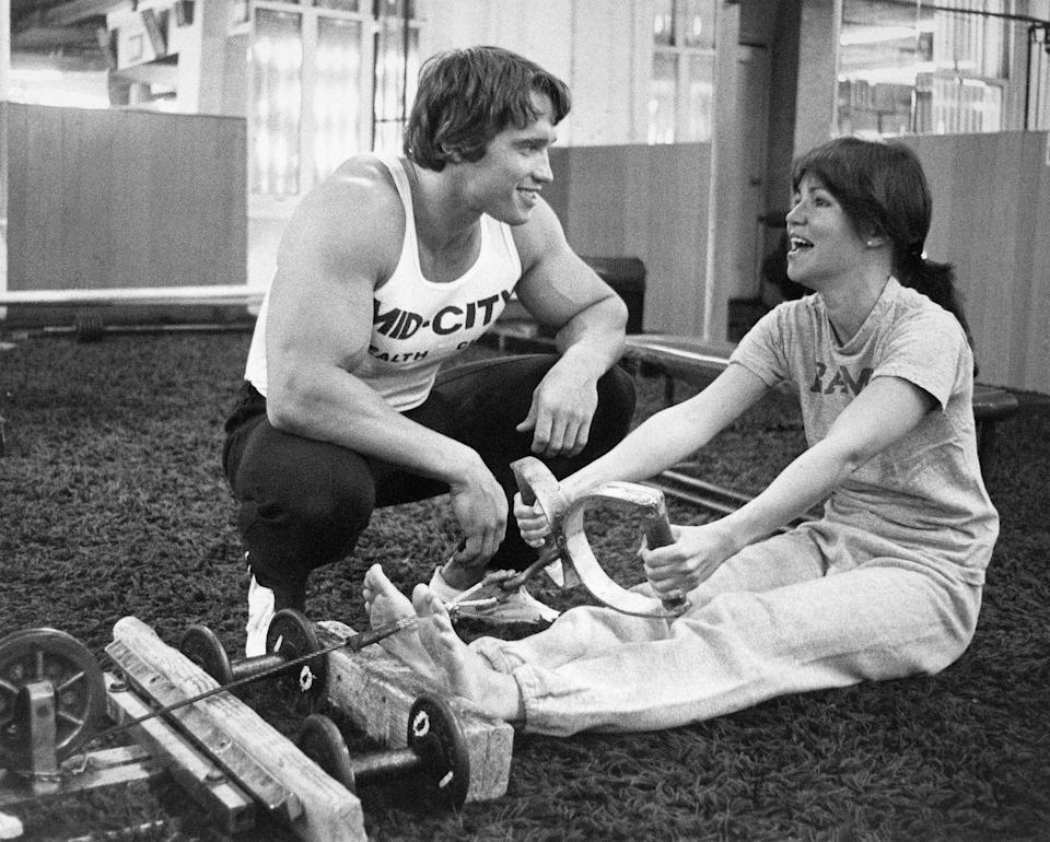 <p>The 1970s was the time when exercising really became more mainstream, especially for women. And it was popular in Hollywood, too: here, Arnold Schwarzenegger, a bodybuilder at the time, trains Sally Field on the rowing machine. <br></p>