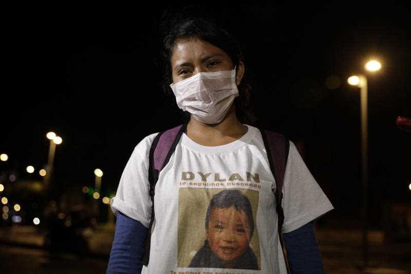 Juana Pérez wears a t-shirt asking for info about her missing son Dylan, 2.