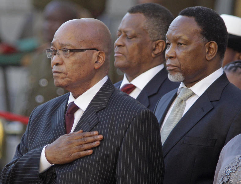 FILE - This Thursday, Feb. 9, 2012 photo from files shows South African president Jacob Zuma, left, and deputy president Kgalema Motlanthe, right, during the opening of Parliament in Cape Town, South Africa. South Africa's governing African National Congress political party will return Sunday, Dec. 16, 2012, to where it first formed a century ago to fight apartheid, to pick its next leader, at a time some believe the movement is fighting to regain its moral high ground. (AP Photo Schalk van Zuydam-File)