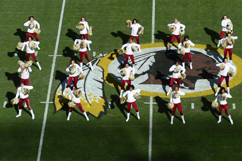 Washington cheerleaders dance on the field before a game against Detroit at FedExField on Nov. 24, 2019 in Landover, Maryland. (Photo by Patrick McDermott/Getty Images)