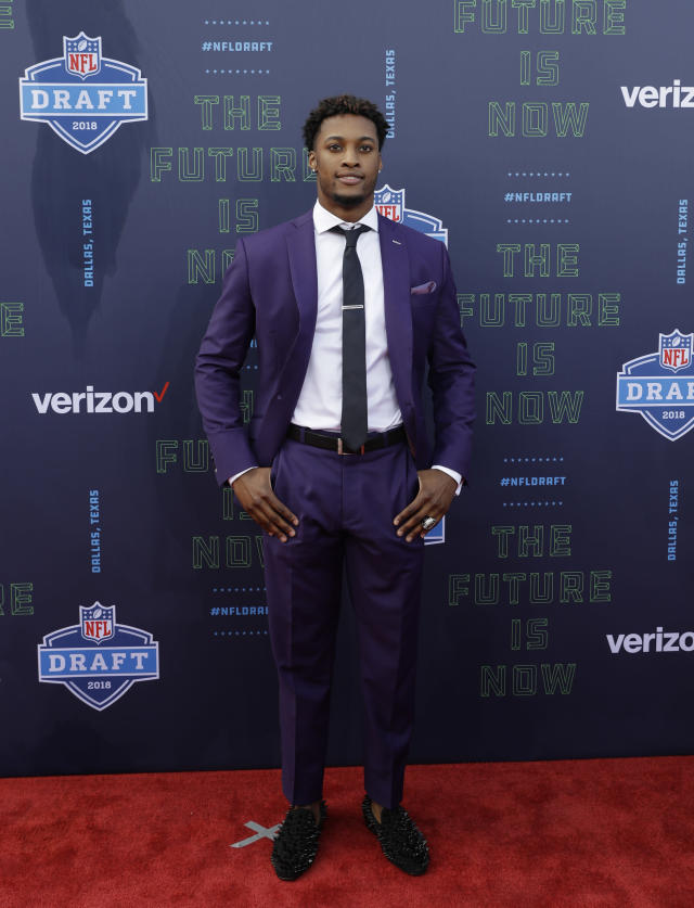 Ohio State's Denzel Ward poses for photos on the red carpet before the first round of the NFL football draft, Thursday, April 26, 2018, in Arlington, Texas. (AP Photo/Eric Gay)