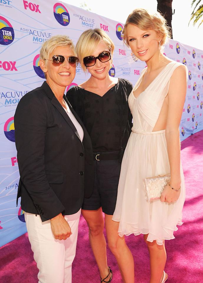 TV personality Ellen DeGeneres, actress Portia de Rossi and musician Taylor Swift arrive at the 2012 Teen Choice Awards at Gibson Amphitheatre on July 22, 2012 in Universal City, California.