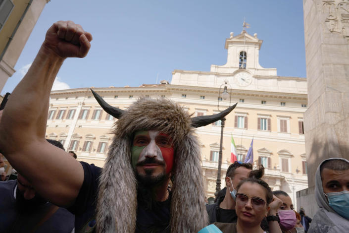 Demonstrators gather outside the lower Chamber during a protest by Restaurant and shop owners in Rome, Tuesday, April 6, 2021. Demonstrators demanded to reopen their business and protested against restrictive measures by the Italian Government to cope with the surge of COVID-19 cases. (AP Photo/Andrew Medichini)