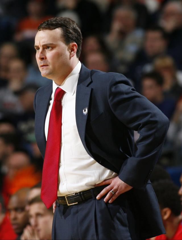 Dayton coach Archie Miller reacts during the first half of a third-round game against Syracuse in the NCAA men's college basketball tournament in Buffalo, N.Y., Saturday, March 22, 2014. (AP Photo/Bill Wippert)