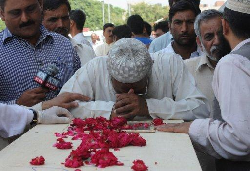 Distraught relatives wept as they collected the shattered remains of loved ones