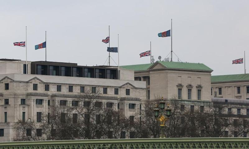 The MI5 building in London with union jack flying at half mast.