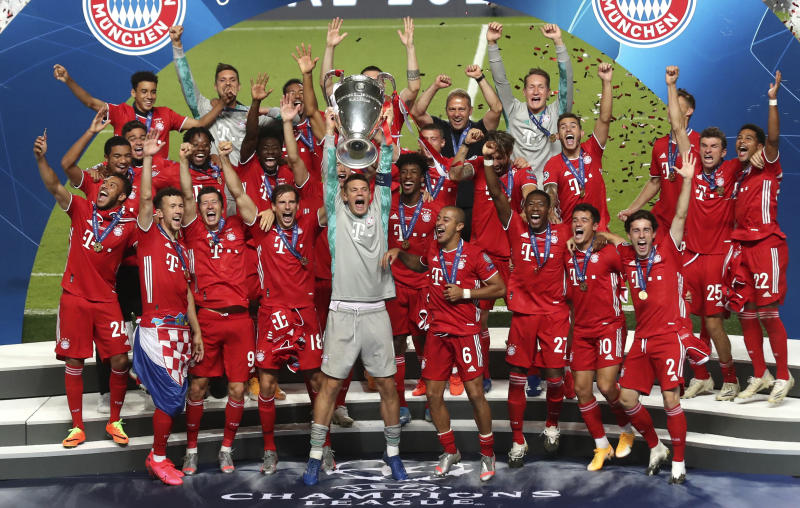 Bayern players celebrate after winning the Champions League final soccer match between Paris Saint-Germain and Bayern Munich at the Luz stadium in Lisbon, Portugal, Sunday, Aug. 23, 2020. (Miguel A. Lopes/Pool via AP)